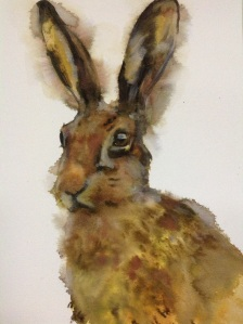 'As if by magic' watercolour hare emerges from the paint, fun technique using lots of water, and spritzed near end of painting for dispersion and bleeding of paint